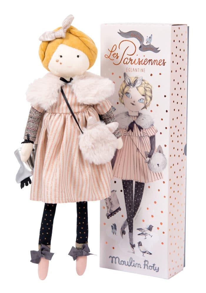 Limited edition rag doll, she is wearing a pink striped dress, fur stole and carrying ice skates. She is pictured with her display box - Moulin Roty 642 526