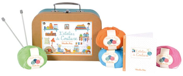 Suitcase containing haberdashery, pictured with balls of wool and knitting needles - Moulin Roty 710 404